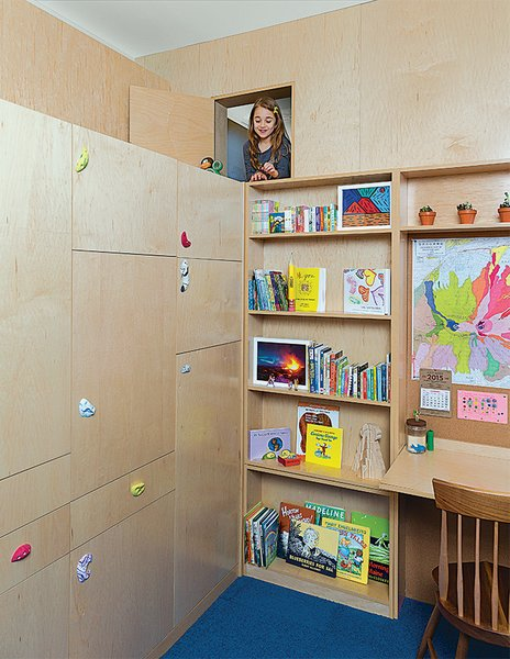 Liv's 144-square-foot room now boasts a custom play area that comprises a reading nook, a loft bed with a secret passageway that opens just to the left of a built-in desk, and myriad storage options, all designed by Gus Deardoff, a theatrical set designer, and built by Peter Sobierajski of J&P Construction Services.