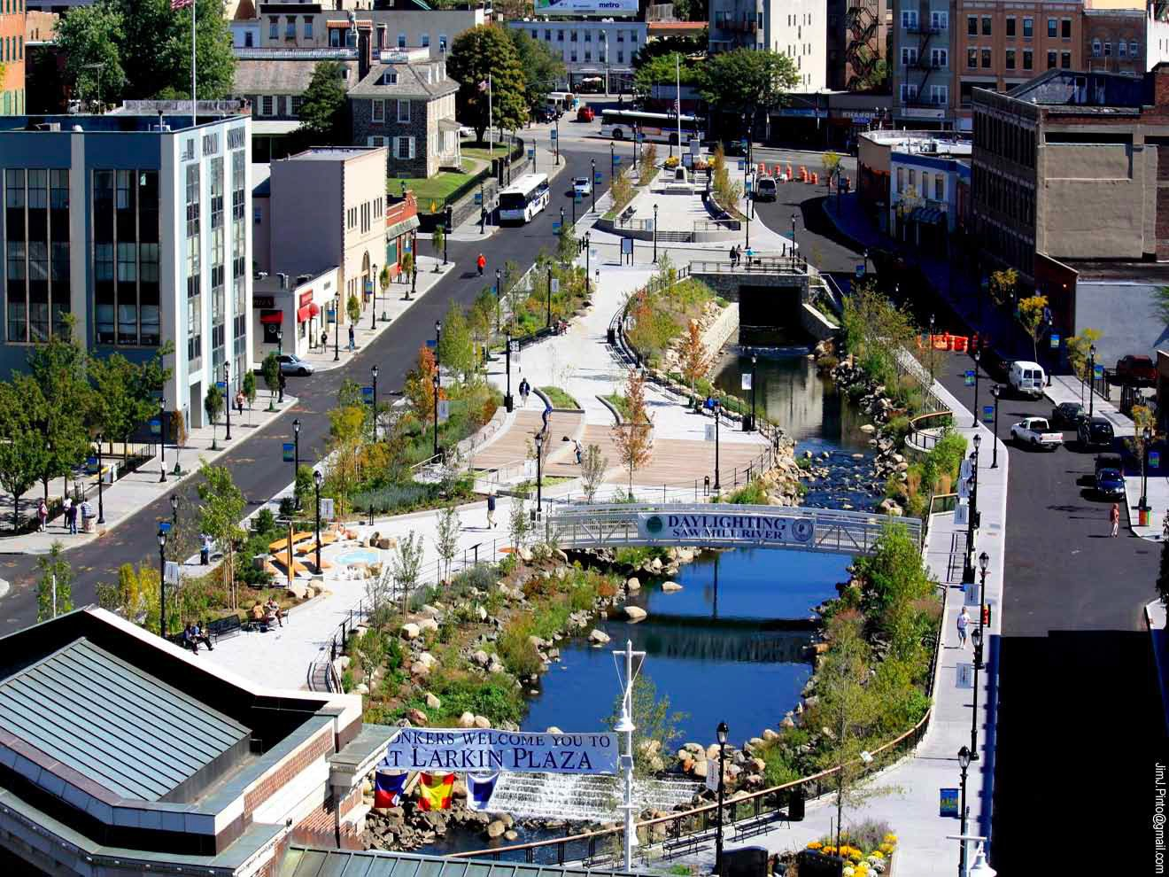 After 80 years spent under public parking lots, the Saw Mill River was resurrected by Saratoga Associates. Winding through the city, the once-forgotten river will now anchor the lively Van der Donck Park. Photo courtesy of Saratoga Associates.  New York Landscape Architects Design Awards by Sara Carpenter