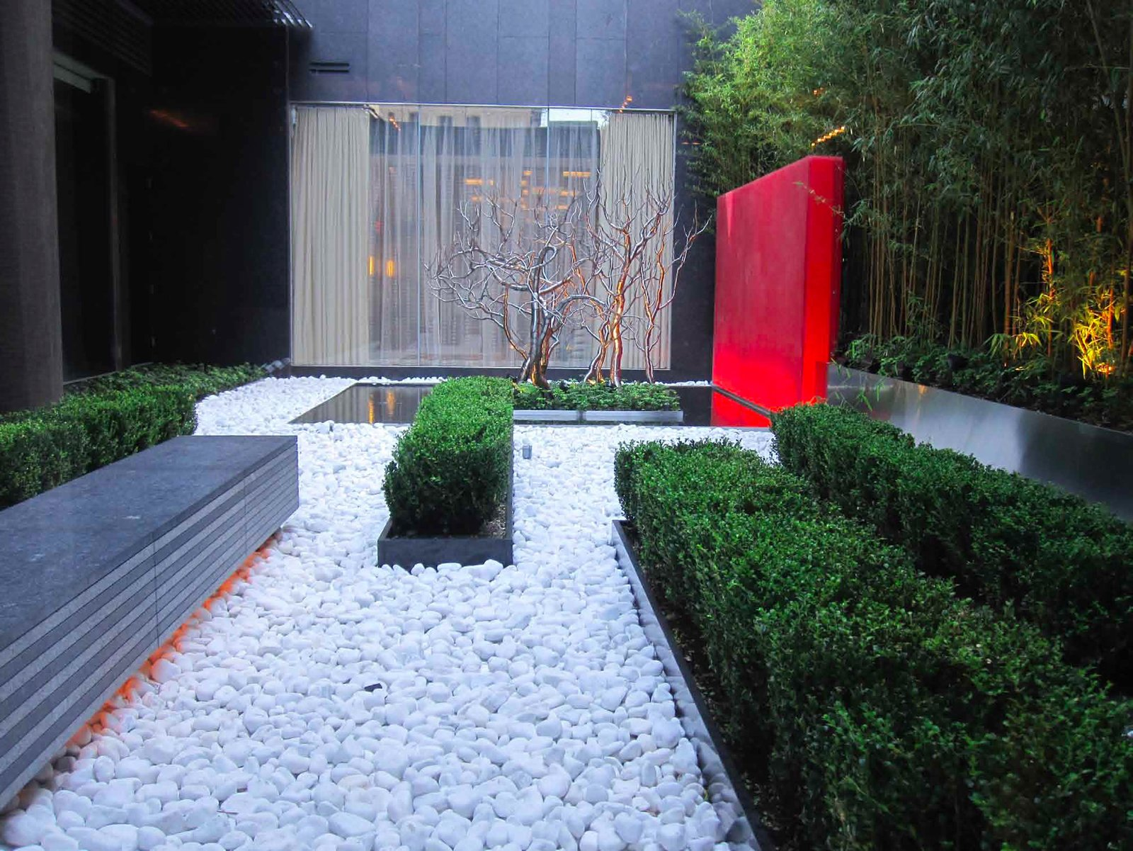 A serene garden courtyard for Intercontinental Hotel lives in an unlikely location – busy and bright Times Square. The four star hotel desired a courtyard with a memorable first impression and Thomas Balsley Associates delivered by creating a noticeable contrast from the hotel's surroundings. Photo courtesy of Thomas Balsley Associates.  New York Landscape Architects Design Awards by Sara Carpenter
