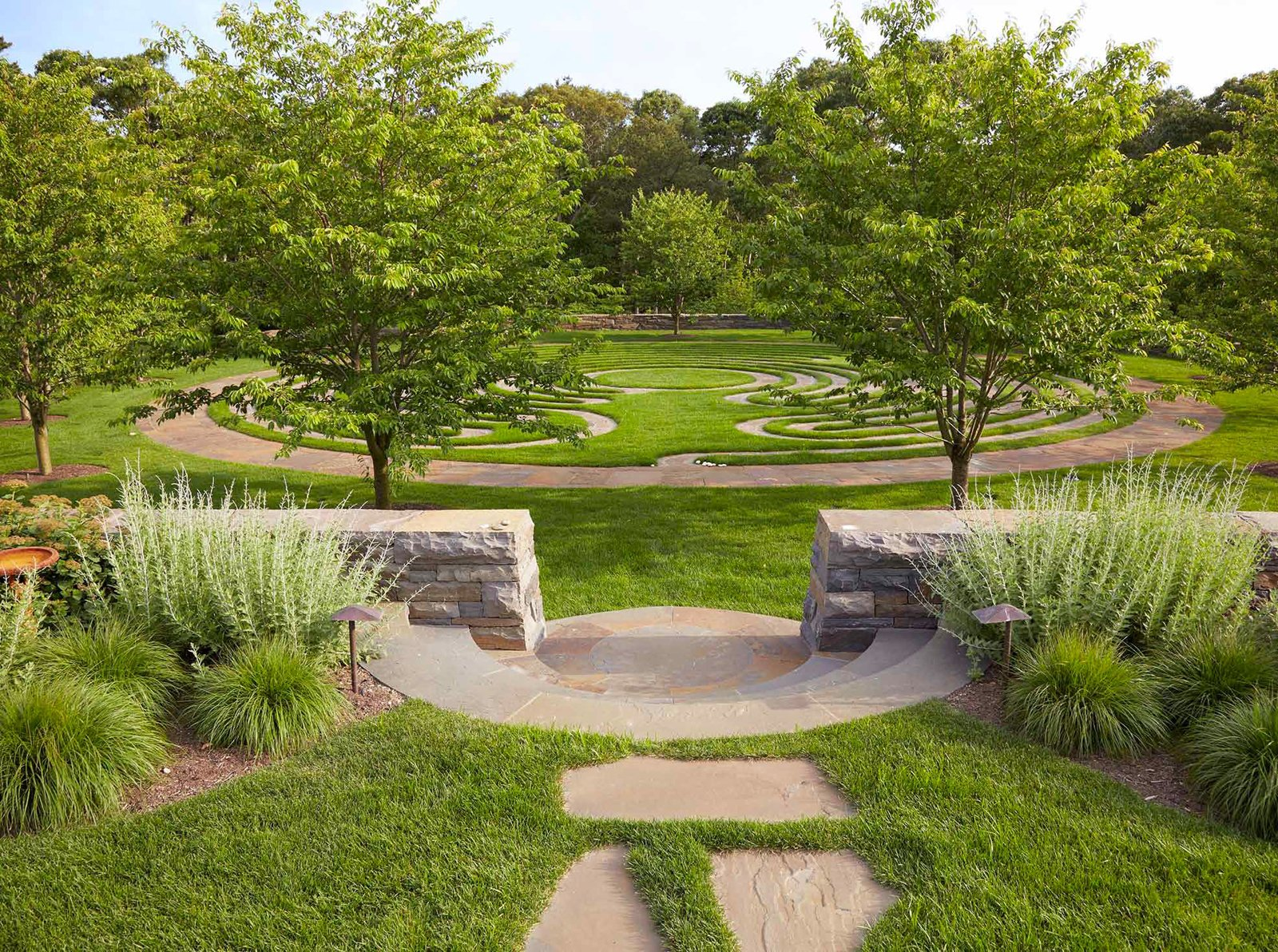 Edmund Hollander Landscape Architects took cues from the natural environment in the landscaping of On The Bluff. Despite several unique elements including a labyrinth, built rock outcrop garden, curving infinity edge retaining pool, and grotto, the built environments blend with nature. Photo courtesy of Edmund Hollander Landscape Architects.  New York Landscape Architects Design Awards by Sara Carpenter