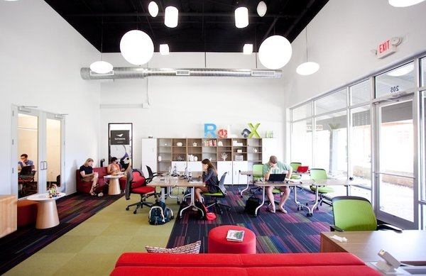 Link (Austin, United States)  Coworking guru Liz Elam, who founded Link as well as the League of Extraordinary Coworking Spaces, designed this collaboration hub with focus and results in mind. While the shared area of the office (pictured above) exudes color and energy, and is rearranged every week to inject a bit of randomness, other workspaces remain subdued. Desks are perpendicular to the windows to reduce glare, walls are kept white, and Elam made sure different work styles were respected. Half the space features low ceilings and white noise for introverts, while a louder, more open section is tailored to extroverts.
