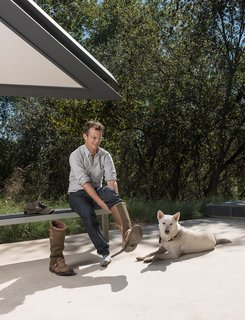 Home owner Chris Brown and his beloved dog Katsu get ready to take Dave on a tour of the Edgeland House land.