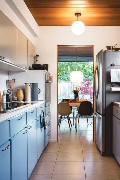 The kitchen in the couple's home retains its original cabinetry.
