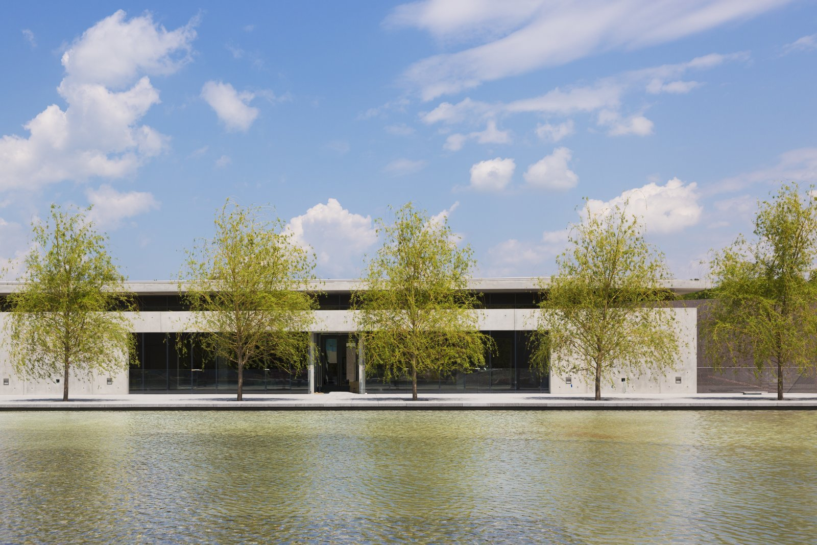 The Clark Art Institute's tiered reflecting pools were conceived by Tadao Ando and developed by Reed Hilderbrand Landscape Architecture. Image courtesy of the Clark Art Institute.  Photo 1 of 7 in Tadao Ando's Reimagined Clark Art Institute