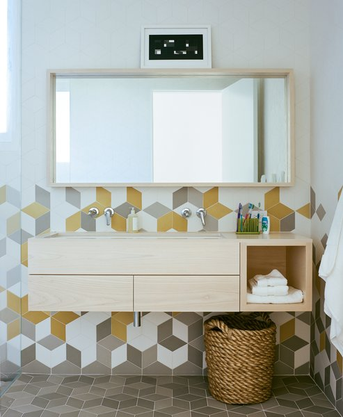 The second-floor bathroom's colorful Tex tiles from Mutina sport an array of different textures for a unique tactile experience.