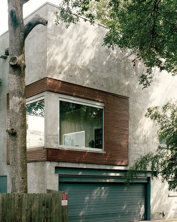 "Exterior, House Building Type, Flat RoofLine, Concrete Siding Material, and Wood Siding Material Lightroom 1.0, a photography studio, is a freestanding structure on the property. ""Together, they represent an autobiography of my career,"" Carpenter says.  Photo 5 of 12 in A Home, Studio, and Gallery Support a Growing Art Scene in Georgia"