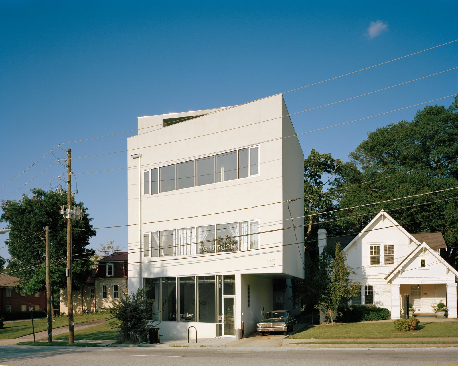 """Exterior, House Building Type, Concrete Siding Material, and Flat RoofLine """"I really believe buildings are part of a city as an organism.""""—William Carpenter, architect and resident  Photo 6 of 12 in A Home, Studio, and Gallery Support a Growing Art Scene in Georgia"""