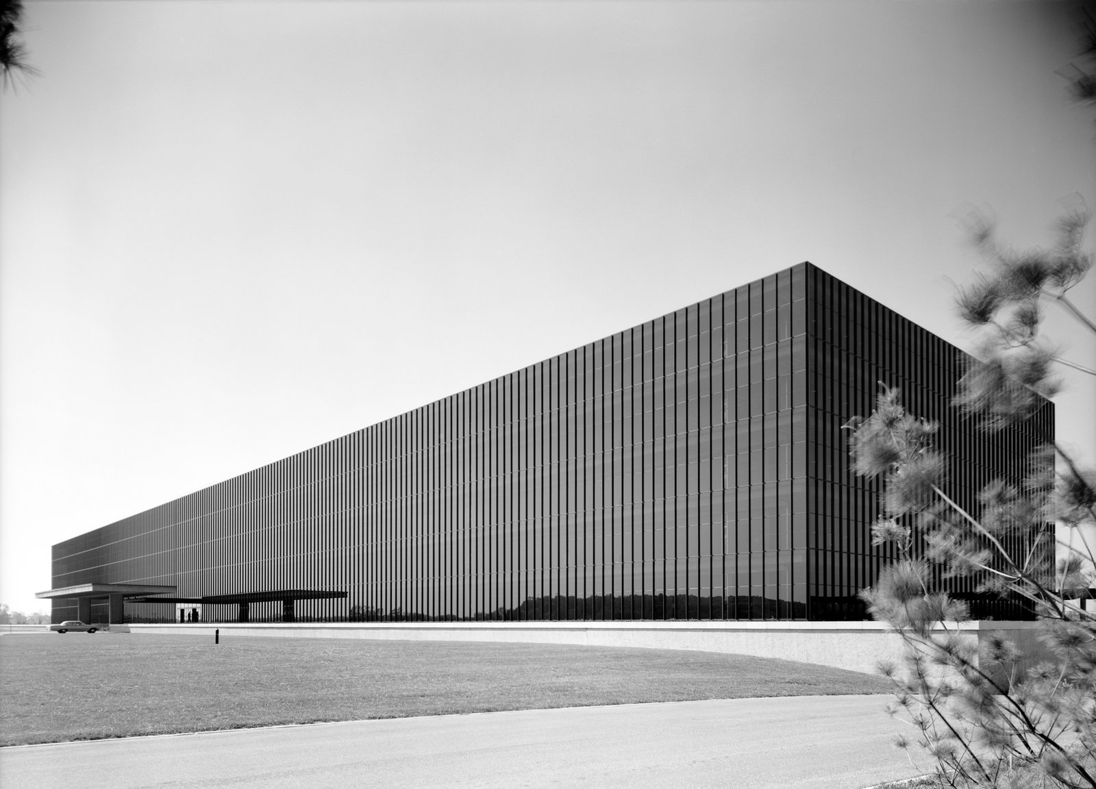 Bell Labs' exterior was the first large-scale application of mirrored glass, a product developed specifically for the project. Now common, especially in sunny climates, the glass's inner layer of aluminum film blocks 70 percent of the sun's heat and admits 25 percent of its light.  Photo 1 of 4 in Eero Saarinen's Giant 1957 Masterpiece in New Jersey Restored and Reimagined