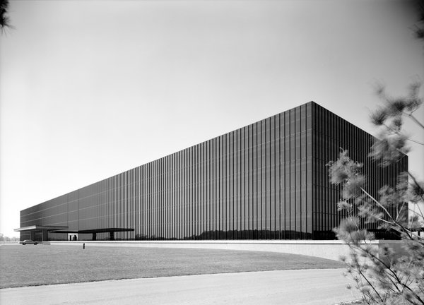 Bell Labs' exterior was the first large-scale application of mirrored glass, a product developed specifically for the project. Now common, especially in sunny climates, the glass's inner layer of aluminum film blocks 70 percent of the sun's heat and admits 25 percent of its light.