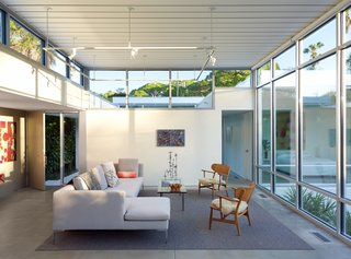 Calling to mind Paul Rudolph's low-slung, midcentury glass pavilions, this Sarasota new-build by Seibert Architects features a roof that can sustain hurricane-level winds as well as sliding doors that open onto a plant-laden courtyard.