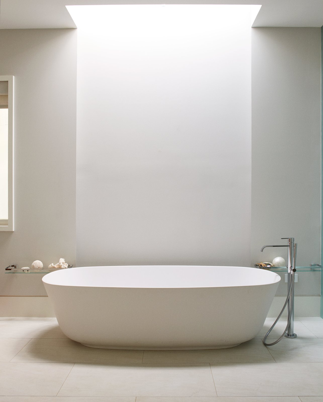 Bath Room and Freestanding Tub A freestanding Antonio Lupi tub defines the updated master bath, which also features an open-plan layout and a skylight by Velux.  Photo 13 of 13 in An Impressive 20-Foot Skylight Transforms a Jumbled Chicago Home