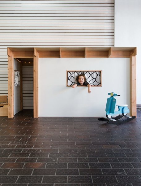 "Children streaming in for a workshop are greeted by an Eichler-inspired playhouse (dubbed the ""Tikeler"") designed and built by The Butterfly Joint's founder, Danny Montoya."