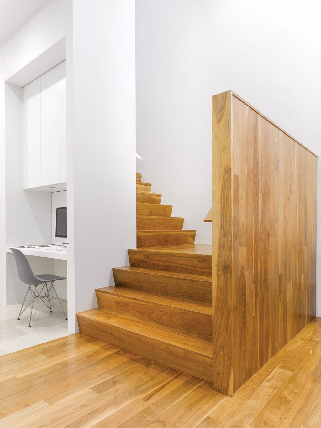 """Staircase and Wood Tread """"We composed the house to have its highest, brightest space in the middle,"""" says Paul Raff. Warm wood stairs lead to the second floor, which houses guest bedrooms, bath, and a kitchenette for the family's frequent visitors.  190+ Best Modern Staircase Ideas from A Modern Toronto House Covered by a Contemporary Solar Screen"""