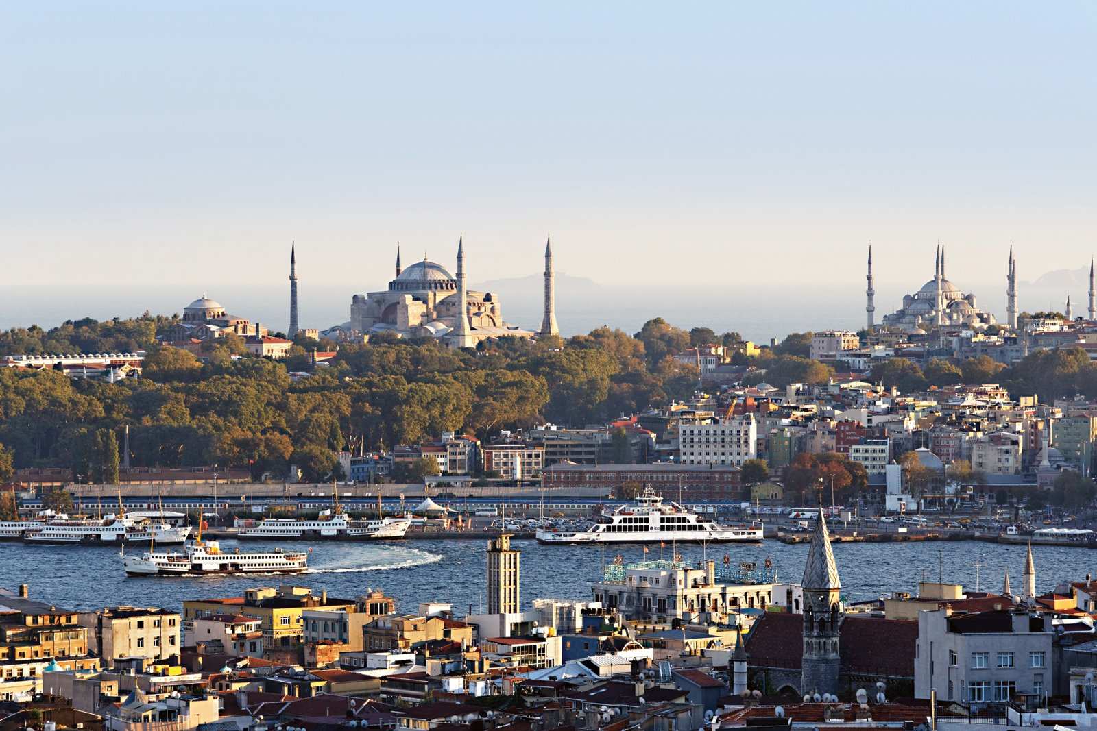 """Looking at Istanbul's old city from the trendy neighborhood of Beyoğlu, one can see the Hagia Sophia at left (rebuilt for the last time in the 6th century) and the 17th-century Sultanahmet (or """"Blue"""") Mosque with its six minarets at right.  Photo 1 of 2 in Istanbul, Turkey"""