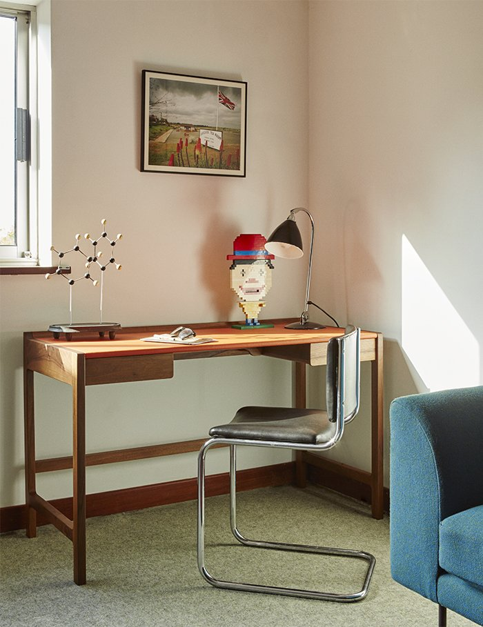 """Office, Desk, and Lamps A 2009 Cedric desk by Kay + Stemmer occupies the study.  Search """"11plus world desk clock"""" from Quirky 1970s House in the English Countryside Showcases an Amazing Modern Furniture Collection"""