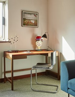 A 2009 Cedric desk by Kay + Stemmer occupies the study.