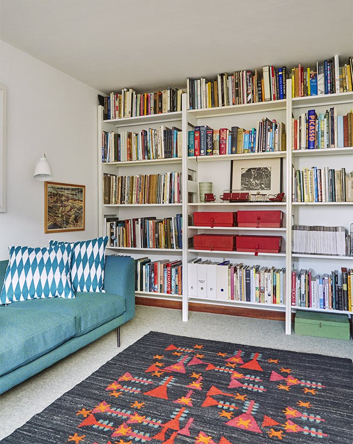 A pressed-steel Parallel shelving system by Terence Woodgate holds books and mementos. Tagged: Living Room, Sofa, and Bookcase.  Photo 11 of 18 in Quirky 1970s House in the English Countryside Showcases an Amazing Modern Furniture Collection