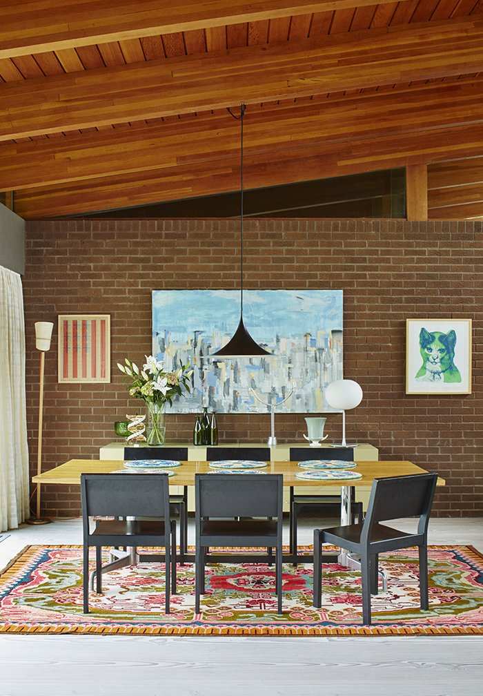 Dining Room, Table, Pendant Lighting, Chair, Rug Floor, and Light Hardwood Floor The dining room features a Glo-Ball T table lamp by Jasper Morrison.  Photo 12 of 18 in Quirky 1970s House in the English Countryside Showcases an Amazing Modern Furniture Collection