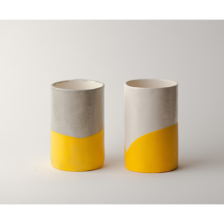 Either as a companion to her new tea kettle or as a stand alone gift, we love these hand-crafted earthenware cups by Chicago-based Susan Dwyer. They've been individually dipped in yellow rubber, giving them a bit of grip and a burst of bright color.