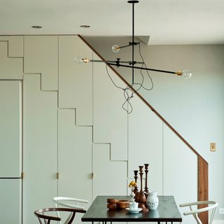 When one thinks of a chandelier, often an elaborate, shimmery fixture comes to mind. With its Industrial Chandelier, Workstead pares this idea down to capture the function of a chandelier—an overhead lighting fixture—with the simplicity of clean lines and a flexible design. The three-arm chandelier can be reconfigured into a variety of shapes, making it an adaptable piece for a many interior spaces. Structured as a horizontal fixture, the Industrial Chandelier can hang just three feet from the ceiling, or as a vertical piece, it can hang five feet for a more dramatic effect. Crafted from steel, repurposed industrial joints, and vintage Hubbell sockets, the lighting fixture has a mechanical, vintage aesthetic, while its minimalist design, exposed cords, and unshaded bulbs have an undeniably modern sensibility.