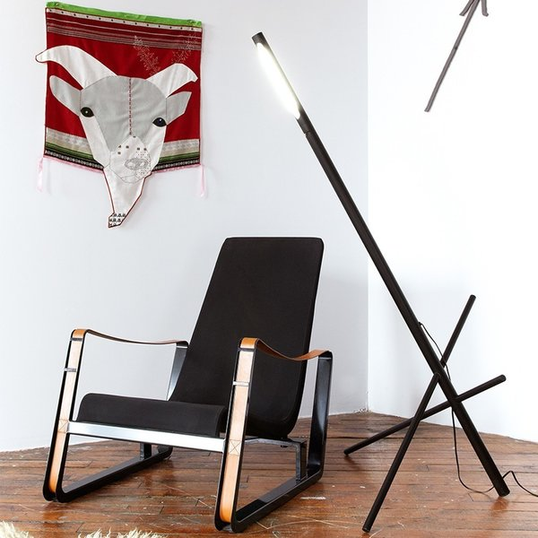 The Axis Floor Lamp from Castor is at once a work of sculpture and a functional light source. Made of precisely machined and anodized aluminum, the light features three poles that intertwine to create a stable structure. The light source, within the main column, is able to rotate 180 degrees, making it easy to adjust light where needed. The other two rods can slide freely through the main column, which adjusts the angle of the light source. The sculptural floor lamp is an undeniable statement-maker, and can be used in a variety of spaces, from minimalist living rooms to industrial offices.