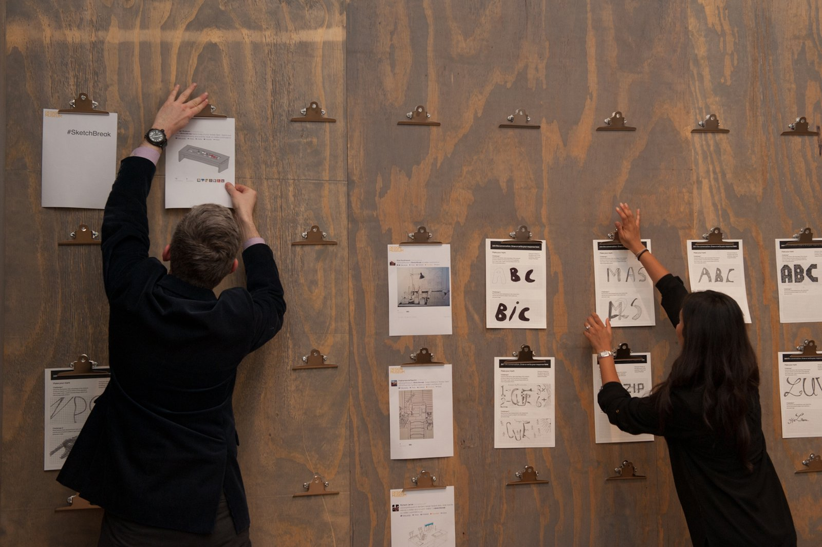 Visitors accept the invitation to design a typeface with pencil and paper, and to vote for their favorite chair via a democratic Tiddlywinks system. Photo by: Max Colson  Design Museum London's Extraordinary Stories about Ordinary Things by Rebecca L. Weber