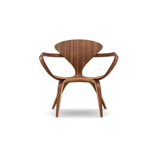 Designed by Benjamin Cherner, the Cherner Lounge Arm Chair is defined by its inviting, curved shape that recalls the original 1958 Cherner chair designed by Benjamin's father, Norman. The molded plywood shell, solid bentwood arm, and laminated wood base flow fluidly into one another, which gives the lounge chair an organic, calming sensibility.