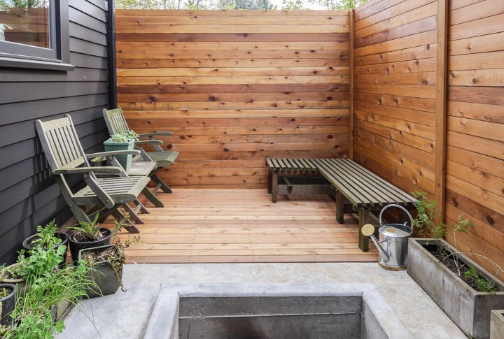 The gap between the house and the fence creates a small patio with space for raised bed vegetable gardening.  30+ Best Modern Fences by William Lamb from Cozy Home in Portland Is Under 800 Square Feet
