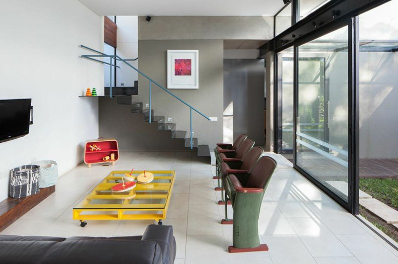 """""""Because of its layout, it can feel like an intimate setting for a couple, or host close to 20 guests if need be,"""" Dumont says.  Photo 6 of 13 in How to Plan Out a Rec Room in Your Home from Idyllic Indoor-Outdoor House in El Salvador"""