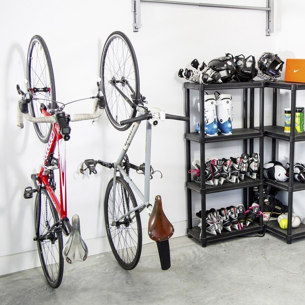 The Clug Bike Rack is an innovative storage solution for hanging bicycles or for supporting a bike on a floor. The Clug is nearly invisible when mounted on a wall, and is designed not only for minimalists who want to avoid the clunky look of a bicycle rack as well as people with limited storage space. The Clug is available in three different sizes that accommodate road, hybrid, and mountain bicycles.  Clever Ideas for Bicycle Storage by Aileen Kwun from Favorite Products from BKLYN Designs