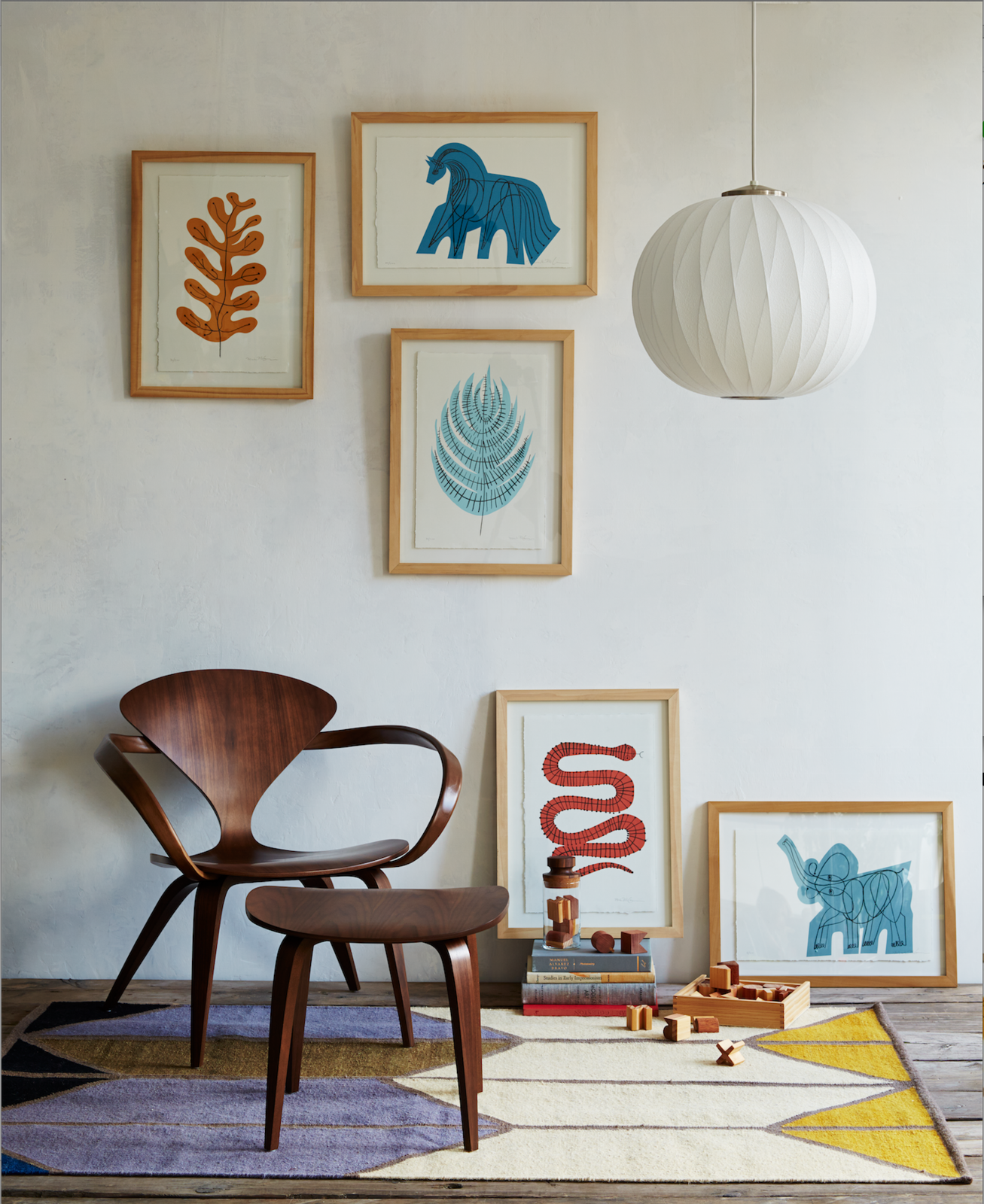 The Menagerie Collection is a series of prints that depict animals and flora in a range of soft, yet vibrant colors. Although compositionally simple, each print is comprised of several parts—the graphic is screen printed on 140 lb. arches watercolor paper, after which McGinnis fills the colored print with a hand-drawn line sketch. From there, the 100 percent cotton paper is mounted and framed in an ash wood frame.   Shown: Yellow Leaf, Blue Horse, Blue Fern, Red Snake, Blue Elephant.  Also pictured: Cherner Lounge Arm Chair, Nelson Bubble Lamp Criss Cross Ball Pendant, and Shapes Rug.  Stuff I like