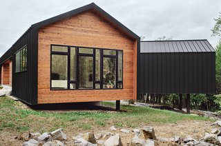 """The metal cladding, inspired by a nearby zinc mine, continues seamlessly onto the house's roof for a minimalist shed effect. """"The drip edge turns to make the wall,"""" explains architect Brandon Pace, """"but changes above the window to accommodate a downspout. Any place where the metal contacts glass, or where you walk underneath, we have an internal gutter."""""""