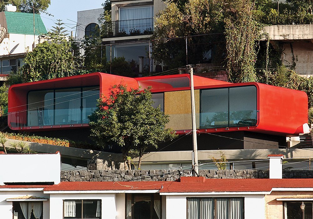One of Rojkind's first commissions, in 2001, was a rooftop apartment for a ballerina above her father's 1960s-era house in the Mexico City suburb of Tecamachalco. Dissatisfied with the look of the Cor-Ten steel exterior, Rojkind hired auto-body workers to finish it with a coat of red automotive paint.  Homes with Distinctive Facades by Allie Weiss from Rojkind Arquitectos is Transforming Mexico City, One Whimsical Building at a Time