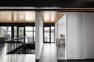 """In addition to adjusting the windows, Carle dislocated all wall partitions from the main structure of the house to create a more open feel. """"This way, we're going back to the mythical plan libre dogma of those days, as a wink to our ancestors,"""" the French-Canadian architect jokes."""