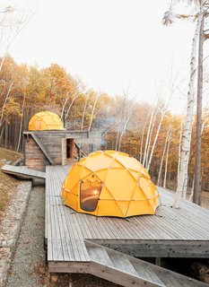 One North Face tent sits atop a deck; another caps the main building, which contains a kitchen and dining area. Photo by: Dean Kaufman