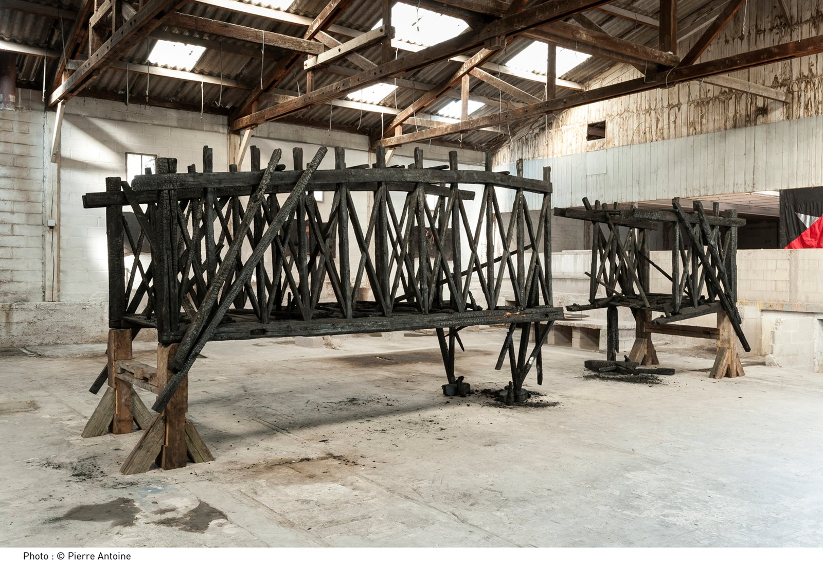 Marianne Vitale's weathervane-centric piece for Frieze will be a departure from past work. Burned Bridge (Montreuil), 2012. Reclaimed lumber. Photograph by Pierre Antoine, courtesy of the artist.  Photo 6 of 6 in Frieze Art Fair: 7 Things Not to Be Missed