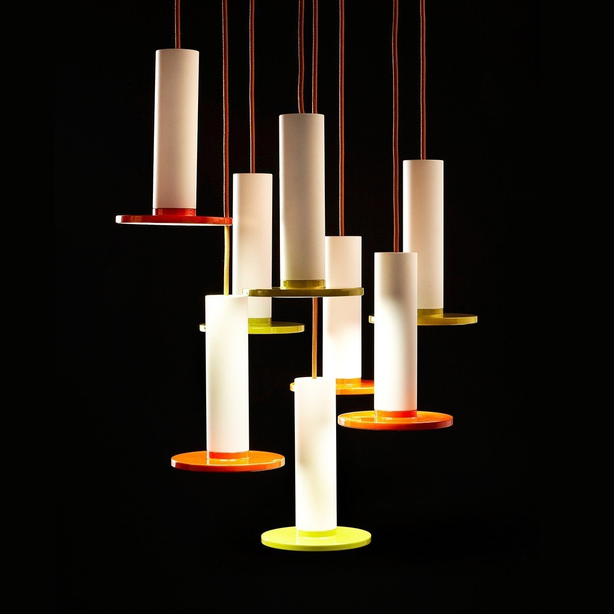 """The Cielo Lamp from Pablo is defined by its use of simple, circular shapes. The lamp is comprised of a cylinder that yields to a flat circular LED panel. The Spanish word for """"heaven"""" and """"sky,"""" Cielo is a pendant lamp, and can be hung from a variety of ceilings, whether the light is used in an entryway or to illuminate a dining room table. This light balances color with a white stem—helping to balance the boldness of the color.  Also available in black.  Modern Pendant Lights with Pops of Color by Marianne Colahan"""