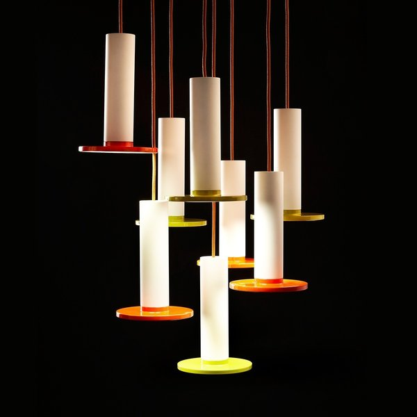 "The Cielo Lamp from Pablo is defined by its use of simple, circular shapes. The lamp is comprised of a cylinder that yields to a flat circular LED panel. The Spanish word for ""heaven"" and ""sky,"" Cielo is a pendant lamp, and can be hung from a variety of ceilings, whether the light is used in an entryway or to illuminate a dining room table. This light balances color with a white stem—helping to balance the boldness of the color.  Also available in black."