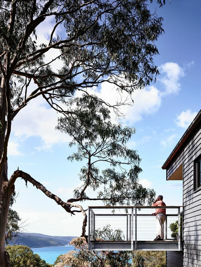 """Outdoor and Small Patio, Porch, Deck The cantilevered deck juts out from the home. """"You really feel like you're floating,"""" Harnkess says.  Unique Modern Decks We Love by Zachary Edelson from A Breezy Modern Beach House Sits Among the Trees in Australia"""