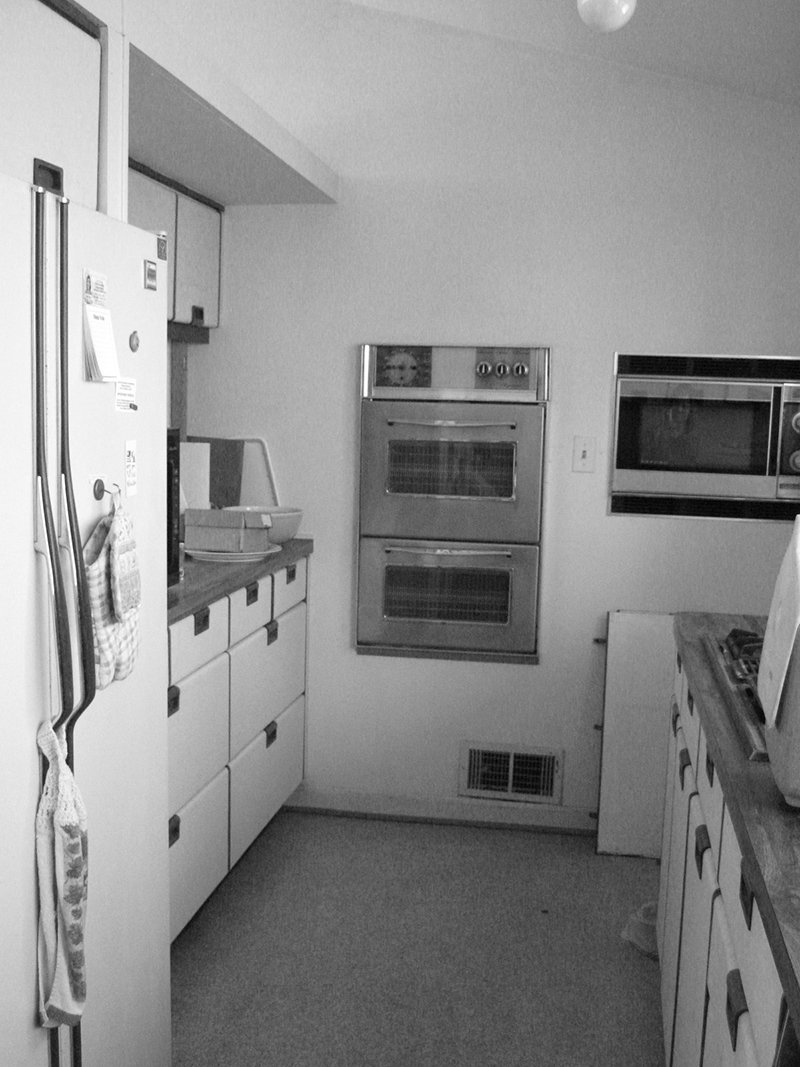 The original kitchen in the 1950 home was cramped and dingy, forcing architect Janet Bloomberg to reimagine the space and open it up to the rest of the living area.  Photo 1 of 6 in Modern Kitchen Renovation with Mid-Century Roots