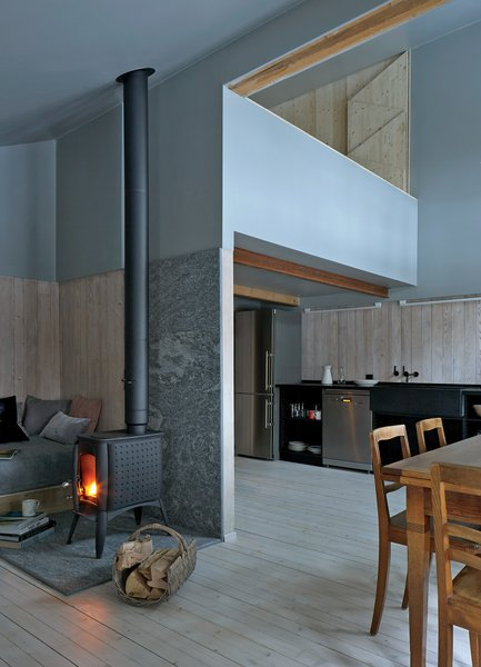 A wood-burning stove in the main room heats much of the house, including the mezzanine and the dining area.  Kitchen from Editor's Picks: 7 Inspiring Small Spaces