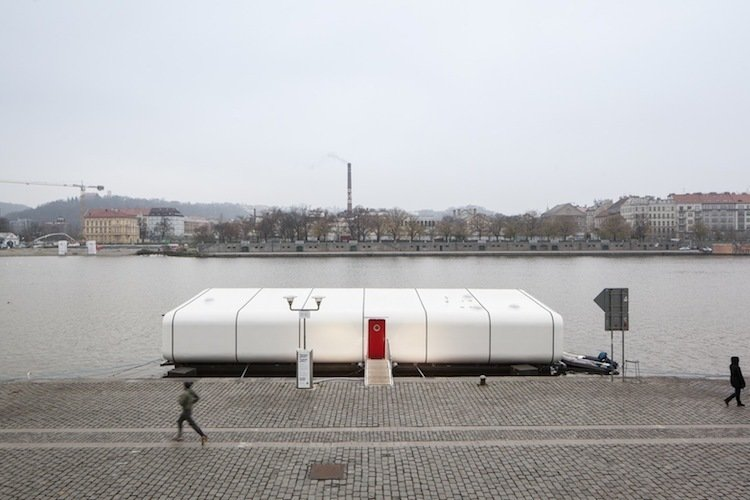 A C-Frame catamaran currently docked in Prague's Holesovice neighborhood, Port X is a buoyant dwelling for modular, modern living. Prague's Atelier SAD finished the concept last fall, collaborating with a company that develops sailing boats to fabricate its curved exterior.  Photo 5 of 7 in Floating Prefab Concept Rethinks the Houseboat