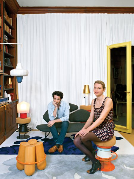 """Jean-Baptiste Souletie and Louise Breguet are the young founders of Parisian manufacturer La Chance. They release """"unlimited"""" editions from primarily European designers, like Note Design Studio, whose Tembo and Bolt stools are shown here in their studio space, a flat in the 16th arrondissement. Photo by: Céline Clanet"""