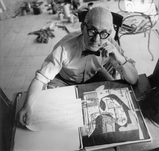 Roll 'em if you got 'em. Corbu shows that even when working hard you can still look effortless.  Photo 4 of 7 in Le Corbusier: The Most Stylish Architect in History from Most Stylish Architect in History: Le Corbusier