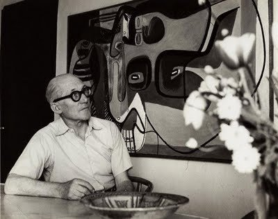 Casual duds here, and perfect proof that one bold accessory (can't get over those glasses) elevates a pretty basic look.  Photo 6 of 7 in Le Corbusier: The Most Stylish Architect in History from Most Stylish Architect in History: Le Corbusier