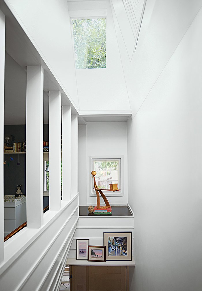 Hallway An alcove in the stairwell displays a white ash sculpture by Bradley.  Small Spaces from Run-Down Row House in Boston Becomes a Quiet Urban Escape with Two Green Roofs