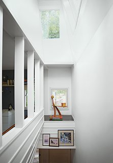 An alcove in the stairwell displays a white ash sculpture by Bradley.