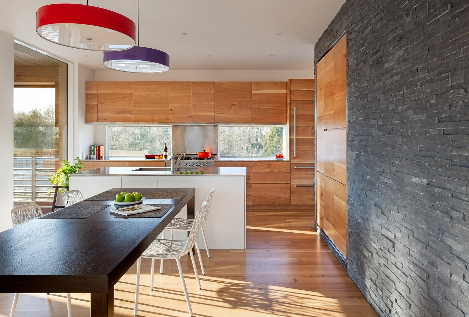Kitchen, Wood Cabinet, Medium Hardwood Floor, and Pendant Lighting  Watch Hill by Diana Budds