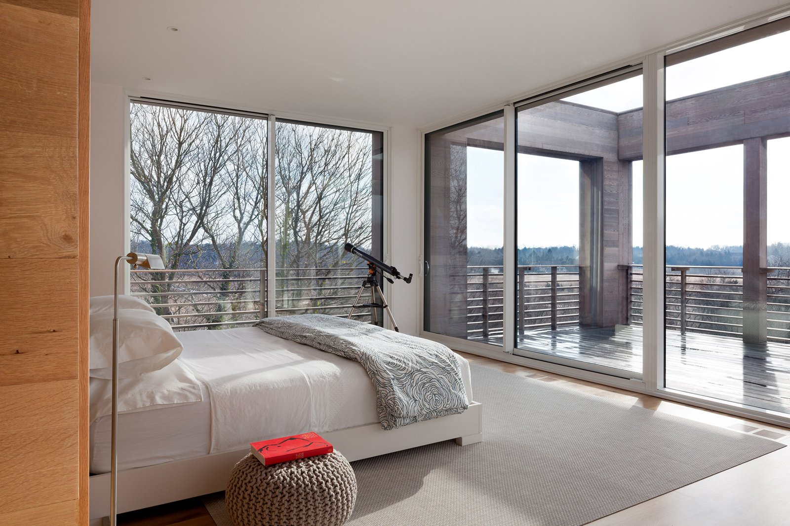 Ciavarra used floor-to-ceiling glass for the master bedroom, which leads onto a deck.  Shining Examples of Clerestory Windows by Luke Hopping from Watch Hill