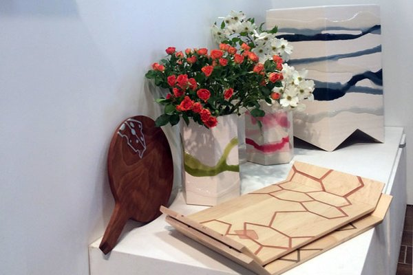 "Molly FitzSimons and Christopher Moore of Noble Goods have recently expanded their line from resin-inlaid hardwood pieces to new ""folded"" tables and planters, each made with a single seam and covered in washes of poured resin."